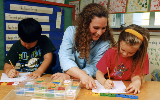 Teacher working with young children